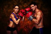 Composite image of boxing couple — Stock Photo