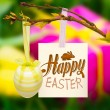 Happy easter graphic against gift box and tulips — Stock Photo #73180889