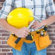 Technician holding hammer and hard hat — Stock Photo #73181811