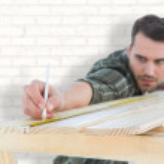 Worker marking on wooden plank — Stock Photo #73184149