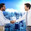 Businessmen shaking hands in office — Stock Photo #73185281