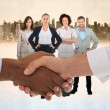 Composite image of close-up shot of a handshake in office — Stock Photo #73187331