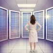 Businesswoman against server room with towers — Stock Photo #73187361