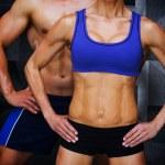 Composite image of bodybuilding couple — Stock Photo #73187829