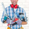 Manual worker holding various tools — Stock Photo #73189149