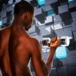 Young man lifting dumbbell — Stock Photo #73189557