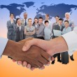 Composite image of close-up shot of a handshake in office — Stock Photo #73189939