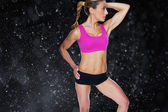 Female bodybuilder posing in pink sports bra — Stock Photo