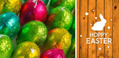 Happy easter graphic against wooden planks — Stok fotoğraf