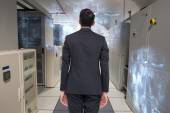 Businessman turning his back to camera — Stock Photo