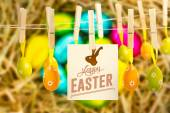 Easter eggs grouped together on straw — Stock Photo