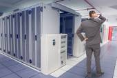 Young businessman against data center — Stock Photo