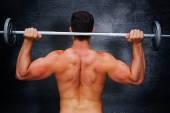 Immagine composita del bilanciere di sollevamento del bodybuilder — Foto Stock
