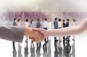 Composite image of handshake between two women — Stock Photo