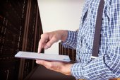 Geeky businessman using his tablet pc — Stock Photo