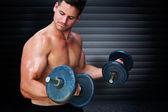 Bodybuilder lifting dumbbells — Stock Photo