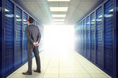 Businessman against server room with towers — Stock Photo