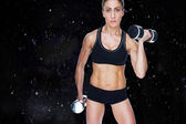 Female bodybuilder working out — Stock Photo