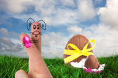 Fingers as easter bunny against easter eggs — Stock Photo