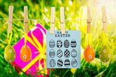 Happy easter graphic against gift with easter eggs — Stock Photo