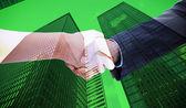 Handshake against skyscraper — Stock Photo