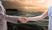 Handshake between two women — Stock Photo