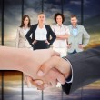 Composite image of close up of a handshake — Stock Photo #73190485