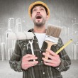 Screaming manual worker holding various tools — Stock Photo #73198569
