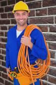 Sorrir faz-tudo com o fio enrolado — Fotografia Stock