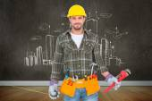 Manual worker holding various tools — Stock Photo