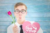 Geeky hipster holding a red rose — Stock Photo