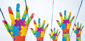Composite image of autism awareness hand — Stock Photo