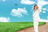 Composite image of thinking businesswoman — Stock Photo