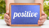 Positive and hands showing chalkboard — Stock Photo