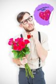Composite image of geeky hipster offering bunch of roses — Stock Photo