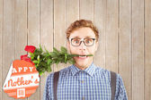 Hipster biting a bunch of roses — Stock Photo
