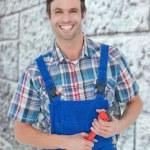 Confident plumber holding monkey wrench — Stock Photo #73200001