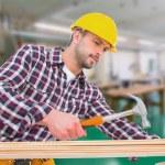 Handyman using hammer on wood — Stock Photo #73200341