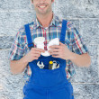 Confident plumber holding sink pipe — Stock Photo #73200549