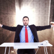 Businessman sitting with arms outstretched — Stock Photo #73201429