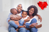 Happy family posing on the couch together — Stock Photo