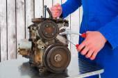 Male mechanic repairing car engine — Stock Photo