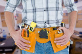Technician with tool belt around waist — Stock Photo