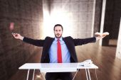 Businessman sitting with arms outstretched — Stockfoto