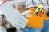 Technician with tool belt around waist — Foto de Stock