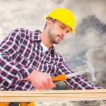 Handyman using hammer on wood — Stock Photo #73222387