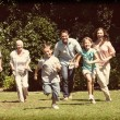 Happy multi generation family running towards camera — Stock Photo #73222553