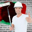 Man holding paint roller while gesturing thumbs up — Stock Photo #73222625