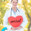 Word social and doctor holding card — Stock Photo #73223041