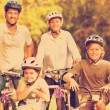 Family with their bikes in a park — Stock Photo #73223403